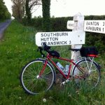 Bike and signpost near Hutton Cranswick